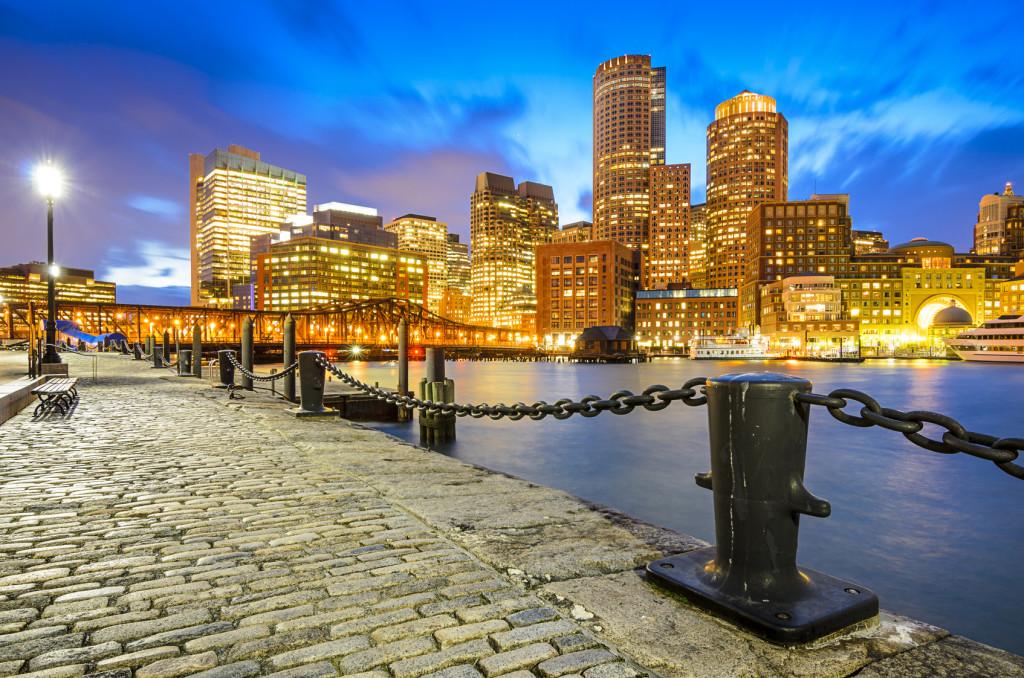 View of Boston's lit-up skyline, taken from Fan Pier