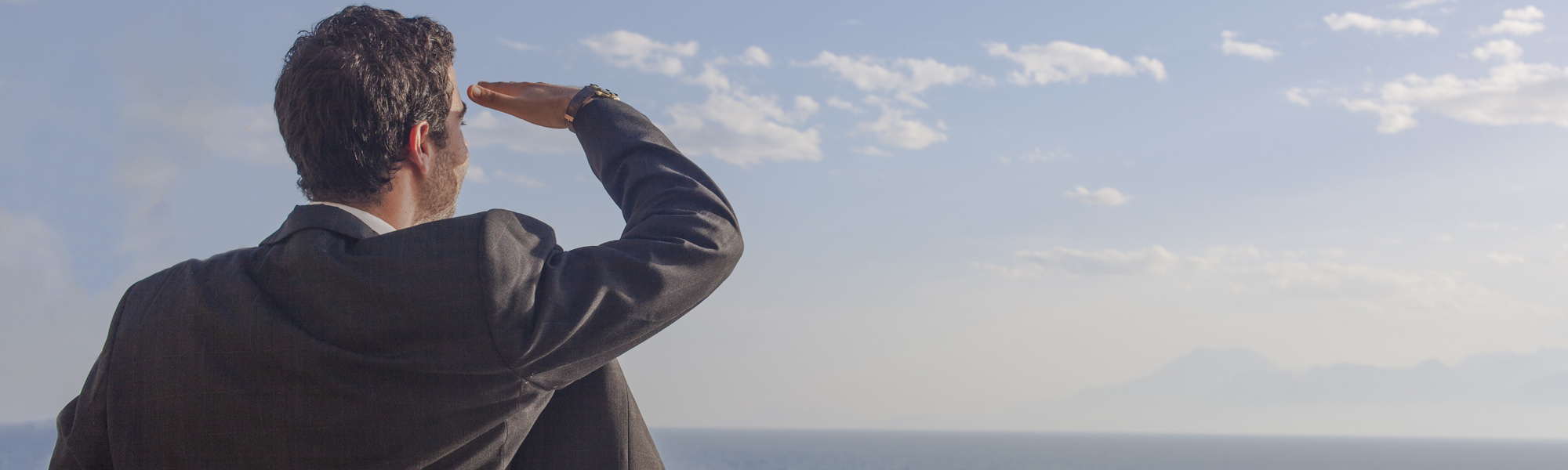 Utility expense management services | Man looking out to sea | Cost Control Associates