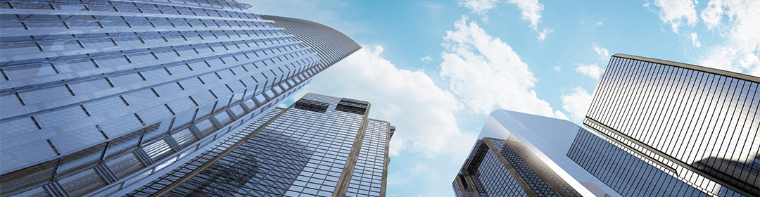 Improve Utility Data Management | Looking at sky thru skyscrapers | Cost Control Associates
