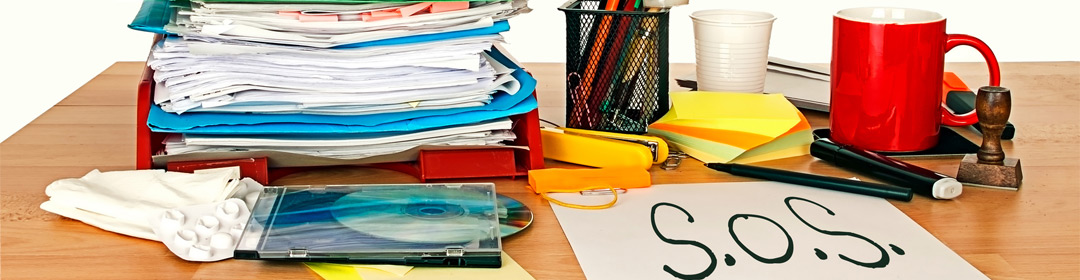 Utility Bill Processing Services | Desk with pile of bills | Cost Control Associates