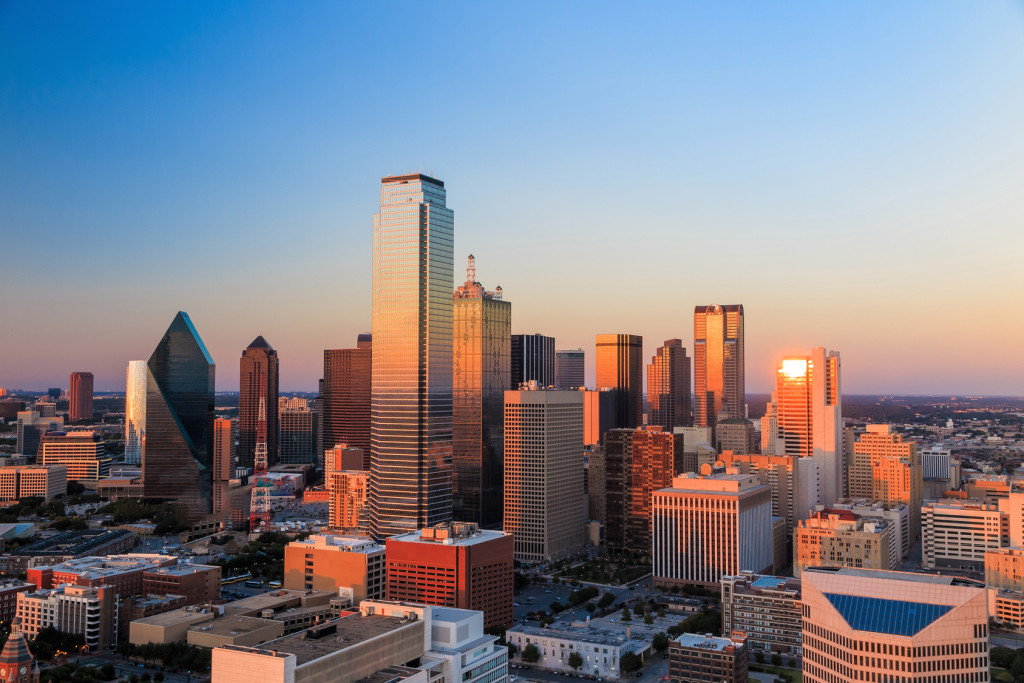 Dallas Texas city skyline as sun sets