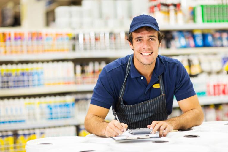 Happy sales person in big box hardware store