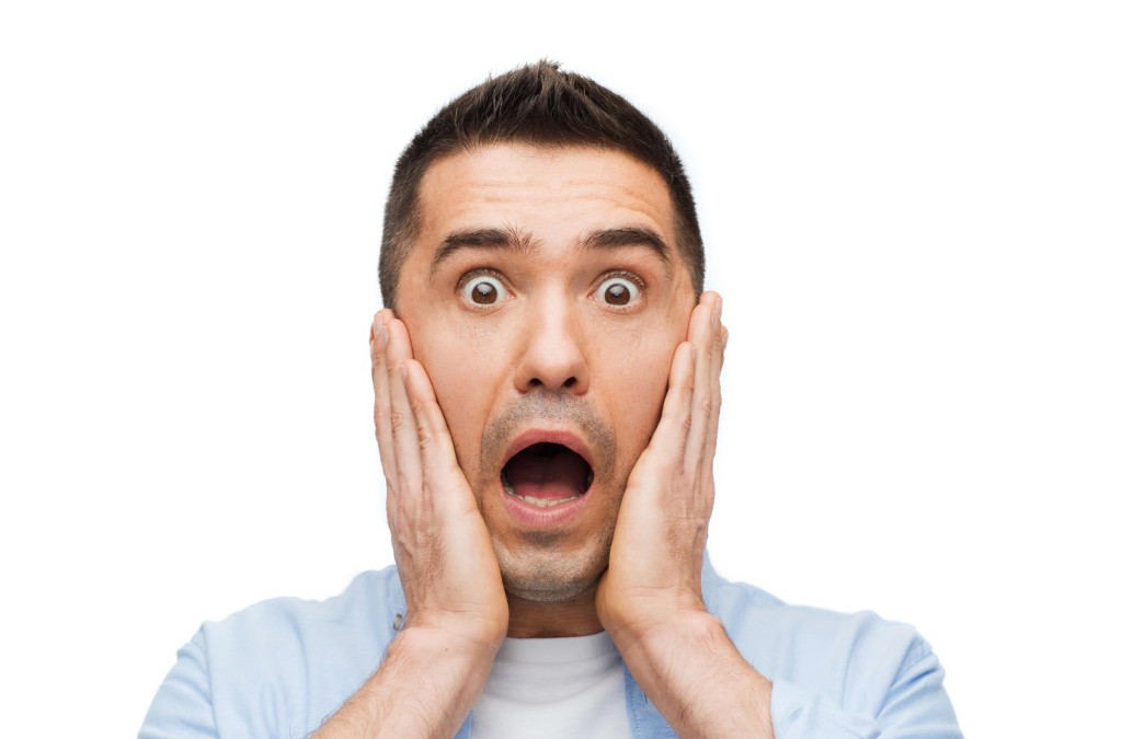 Close-up of man looking horribly surprised