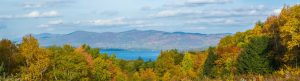 Lake George nestled in Autumn scenery.