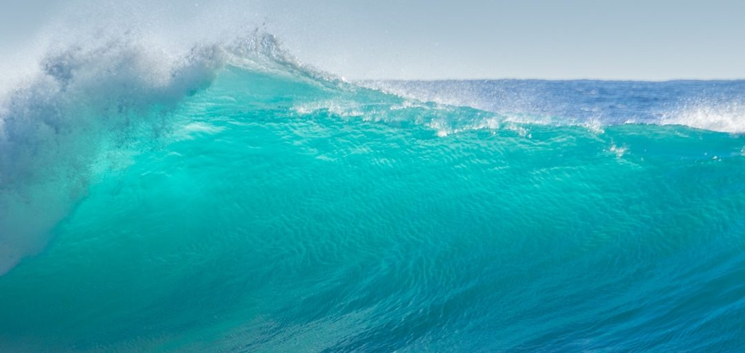 big breaking turquoise ocean wave