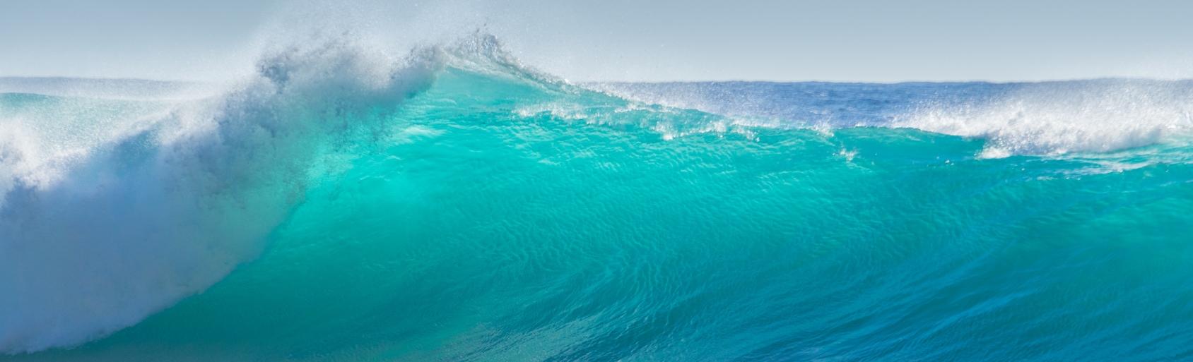 big breaking turquoise ocean wave