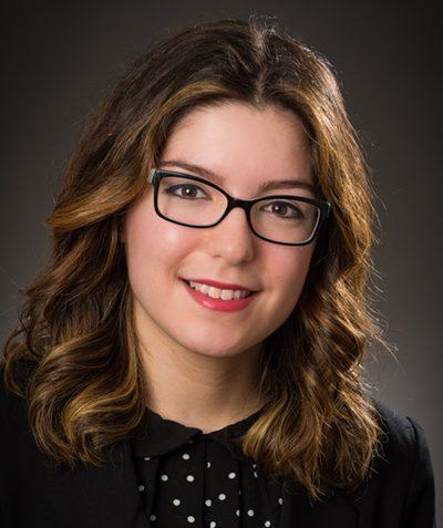 Headshot portrait of employee Dana Sastre