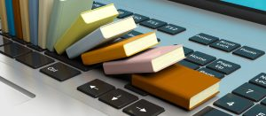 What's that Line Item on My Phone Bill | Row of tiny books lying on computer keyboard