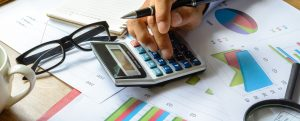 Free Utility Bill Analysis | desktop of spreadsheets, calculator | Cost Control Associates