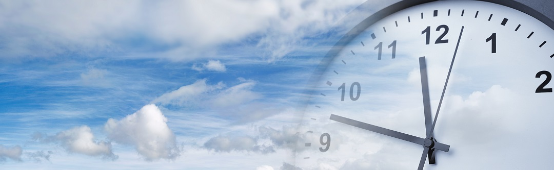 Daylight Savings Time | Clock superimposed over blue sky | Cost Control Associates