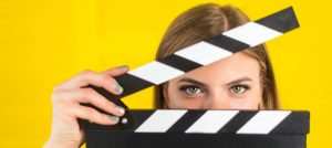Utility Expense Reduction Blog | woman peering through lights-camera-action clapper board | Cost Control Associates