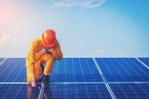 Solar energy Savings | engineer working on solar panels