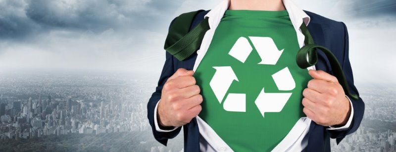 Reduce & Reuse | business man reveals t-shirt with reduce-reuse-recycling symbol