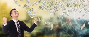 Save money on energy bills | business man happy about dollar bills swirling in the air