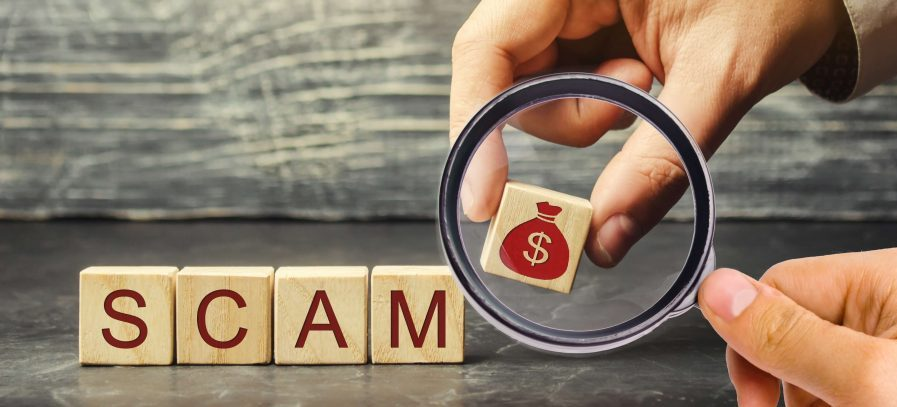 How to Recognize a Utility Scam | Wooden blocks that spell SCAM | Cost Control Associates