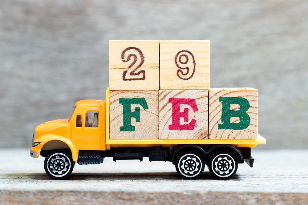 Leap Day Facts | Toy truck loaded with blocks spelling Feb 29 | Cost Control Associates