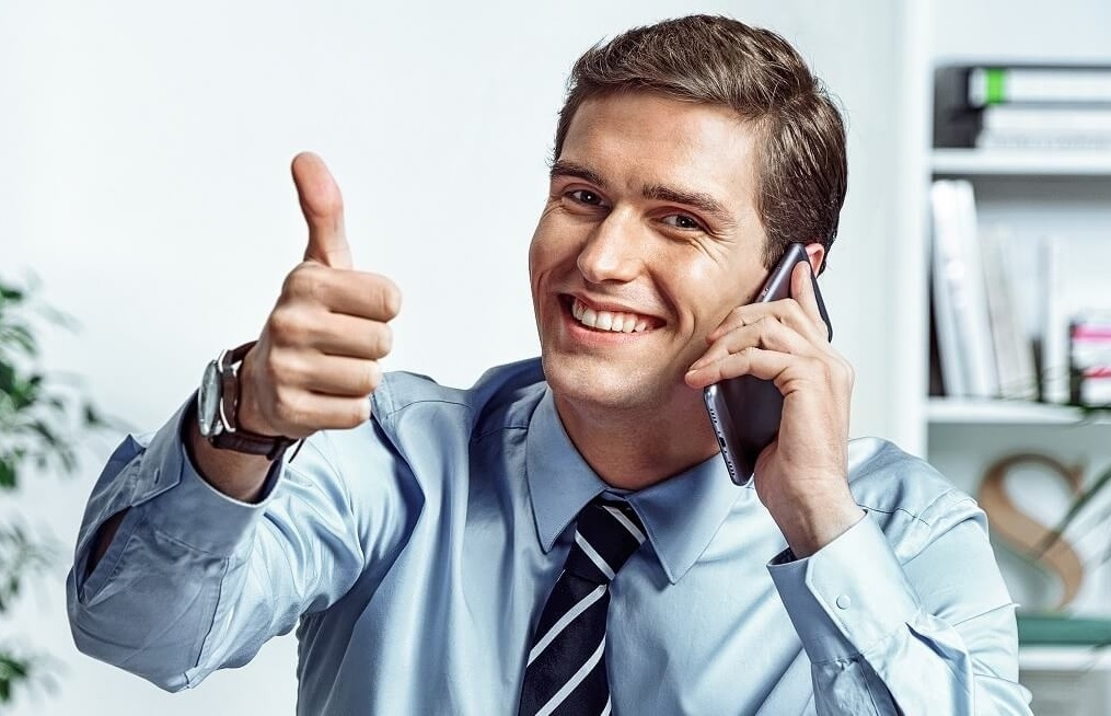 Reduce Business Bank Fees | Man smiling with thumb-up signal | Cost Control Associates