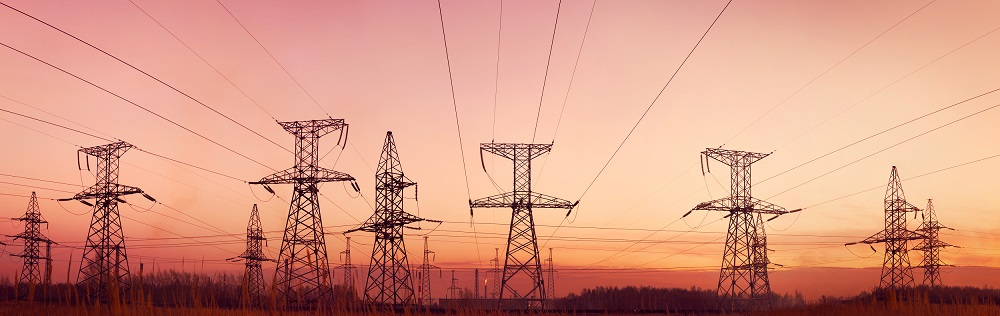 Energy Cost Managment   Electricity towers at dusk   Cost Control Associates